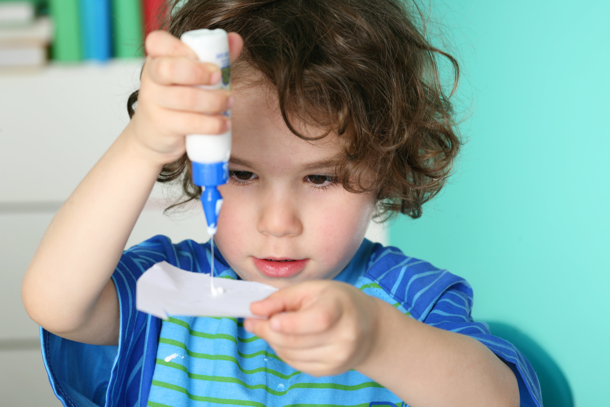 child using glue for crafts