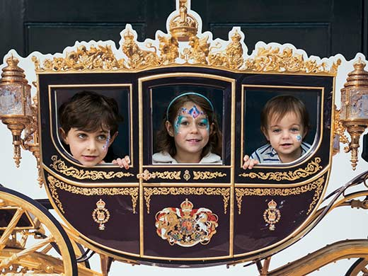 three children in royal carriage