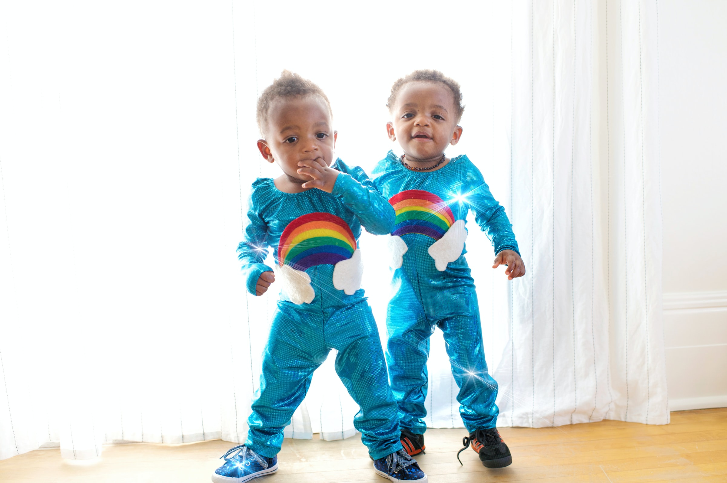 twin babies wearing matching personalised outfits