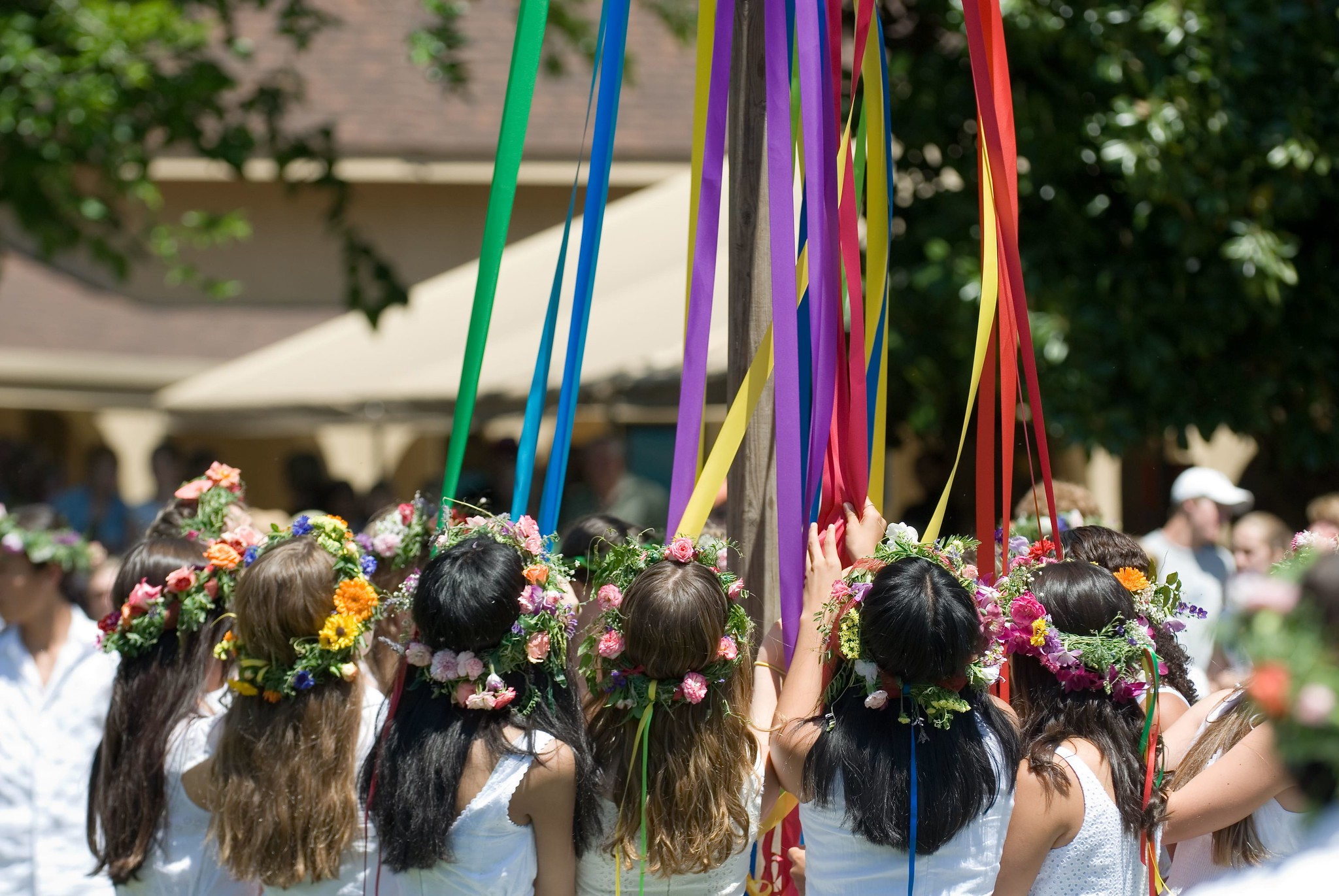 group wearing flower crowns by maypole