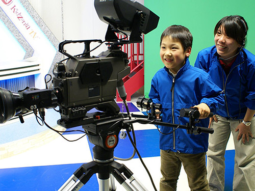 Child playing with camera