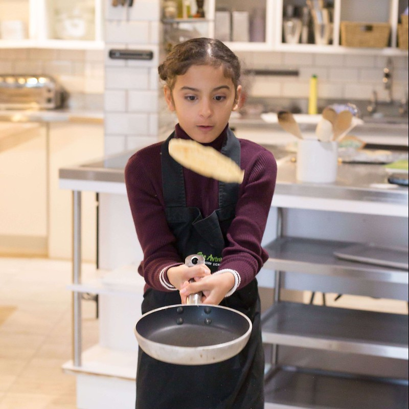 Child learning to cook