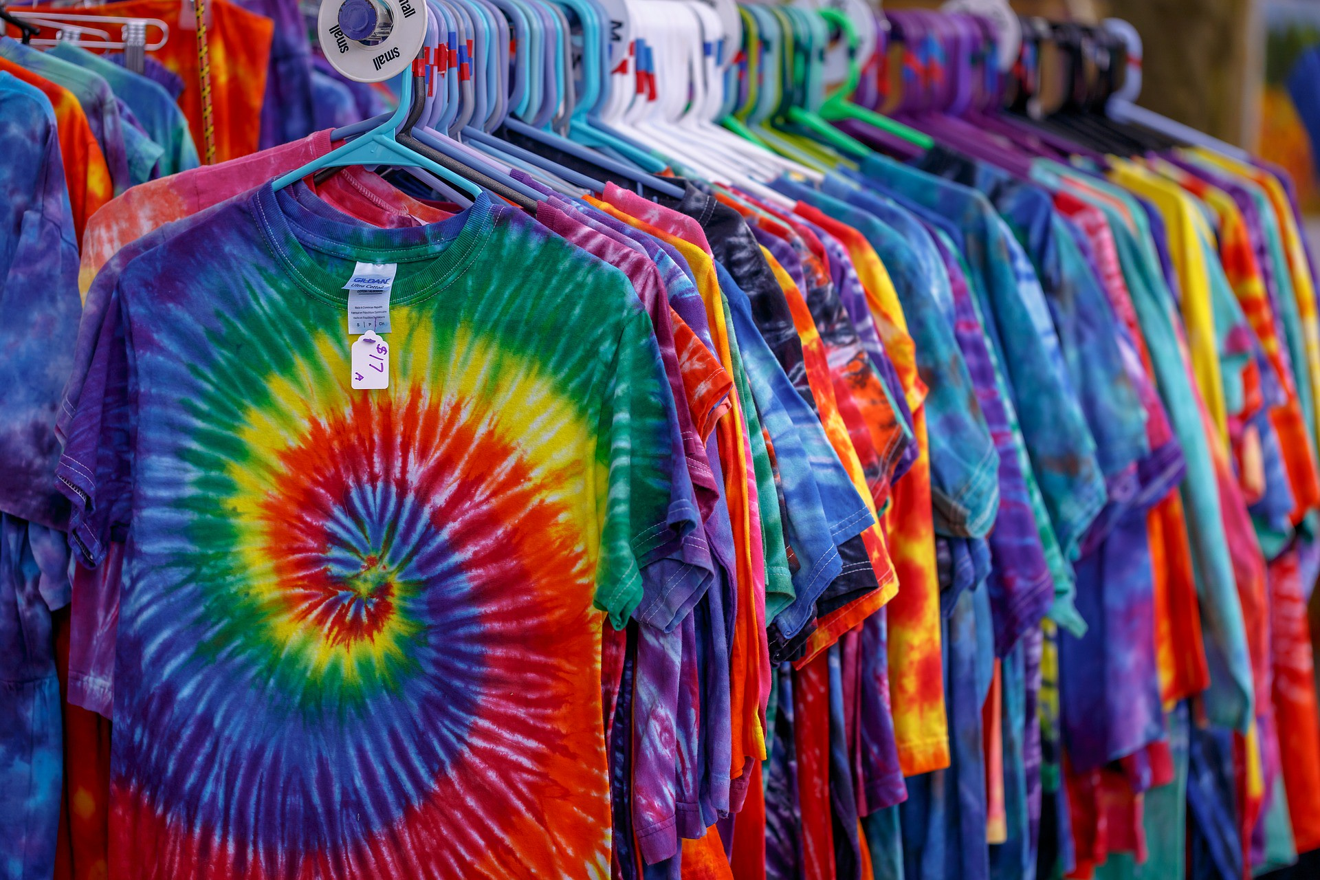 rack of tie-dyed t-shirts