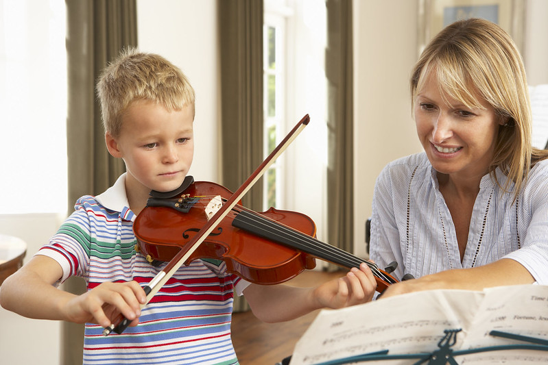 Child learning violin