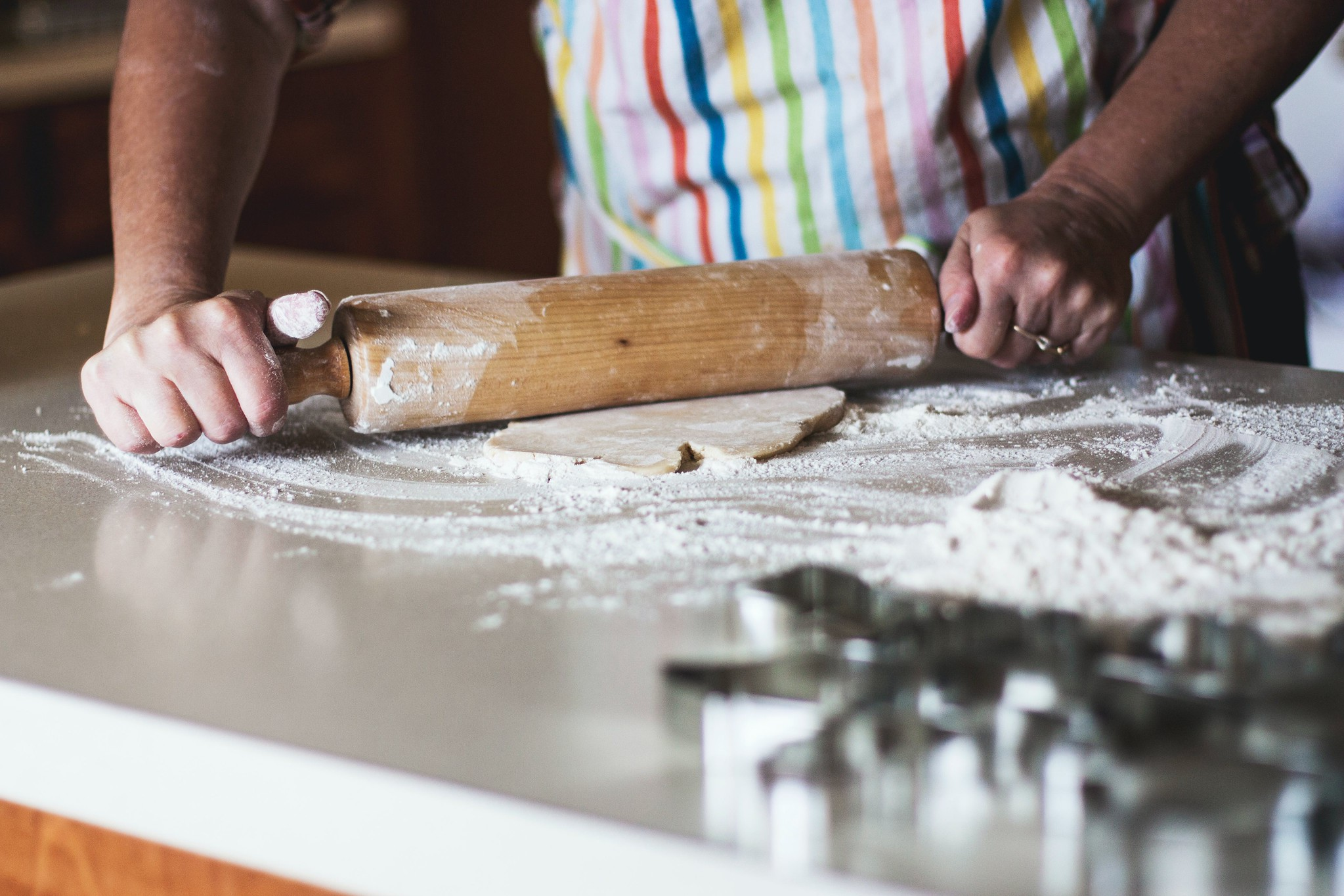 flattening dough with rolling pin