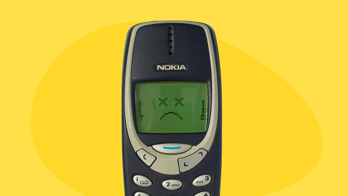 How did Microsoft ruin Nokia - Image contains a Nokia phone over a yellow background