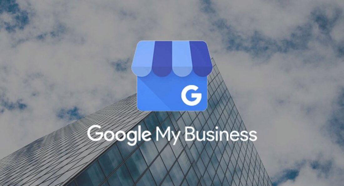 Image contains google my business icon on a background of a building and clouds