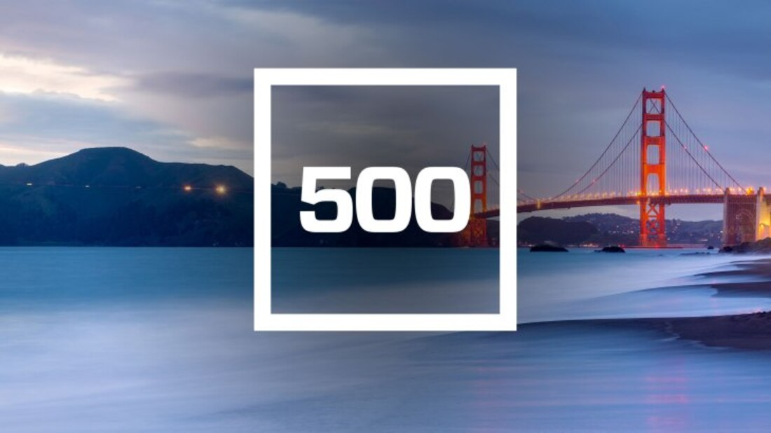 The image contains the number 500 on a background of a bridge