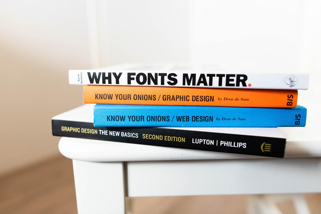 Image contains four books and the first one says why fonts matter