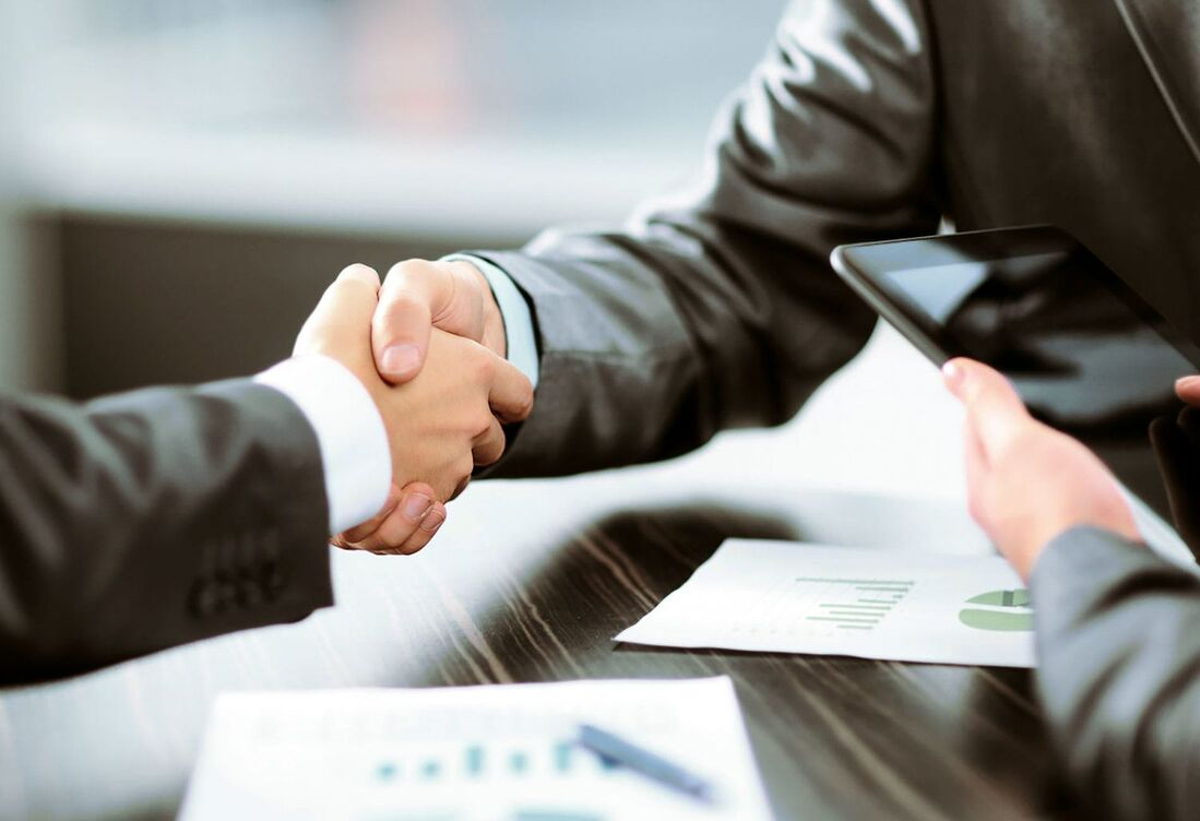 Image contains two people shaking hands