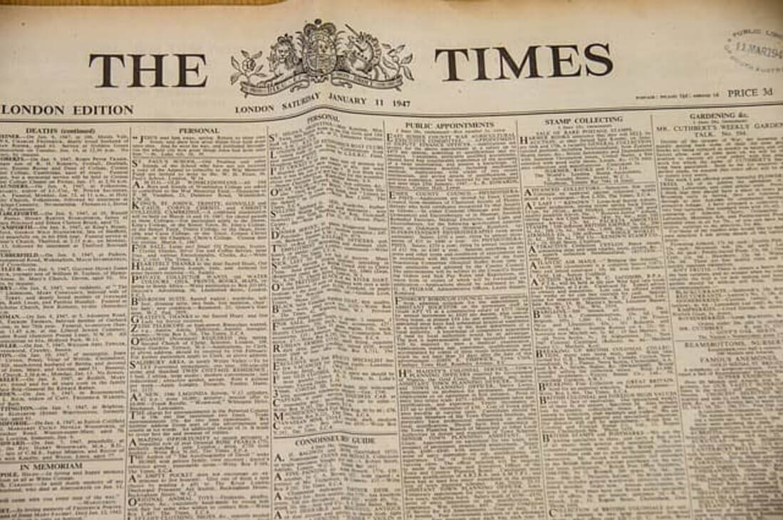 Image contains a newspaper