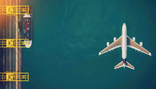 Aerial view of a plane and ship