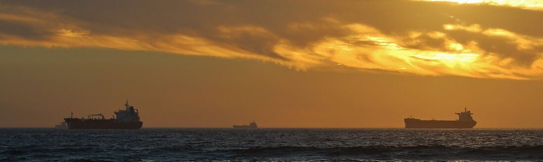 Ships on the ocean at sunset