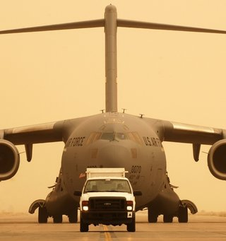 Air force jet taxiing behind a truck