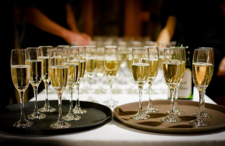 Glasses of champagne on serving trays