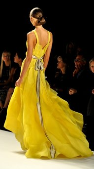 Runway model in a yellow gown