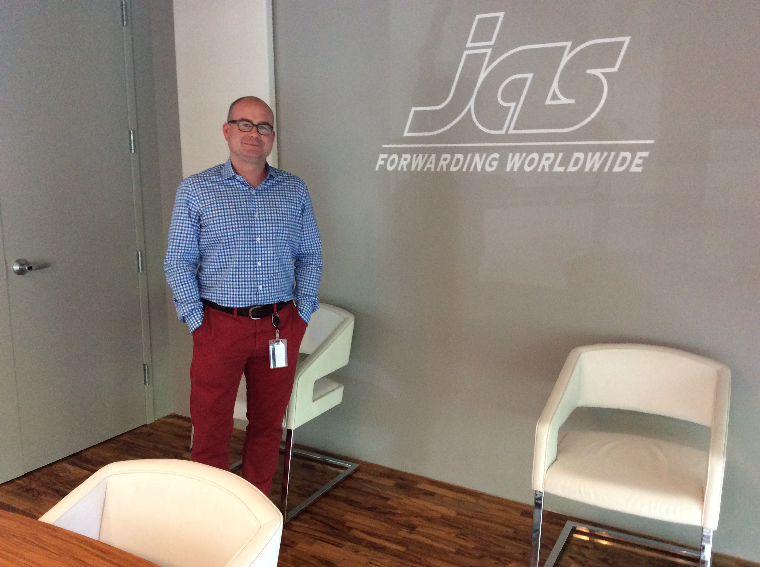 Bjoern Wiede poses in front of JAS logo