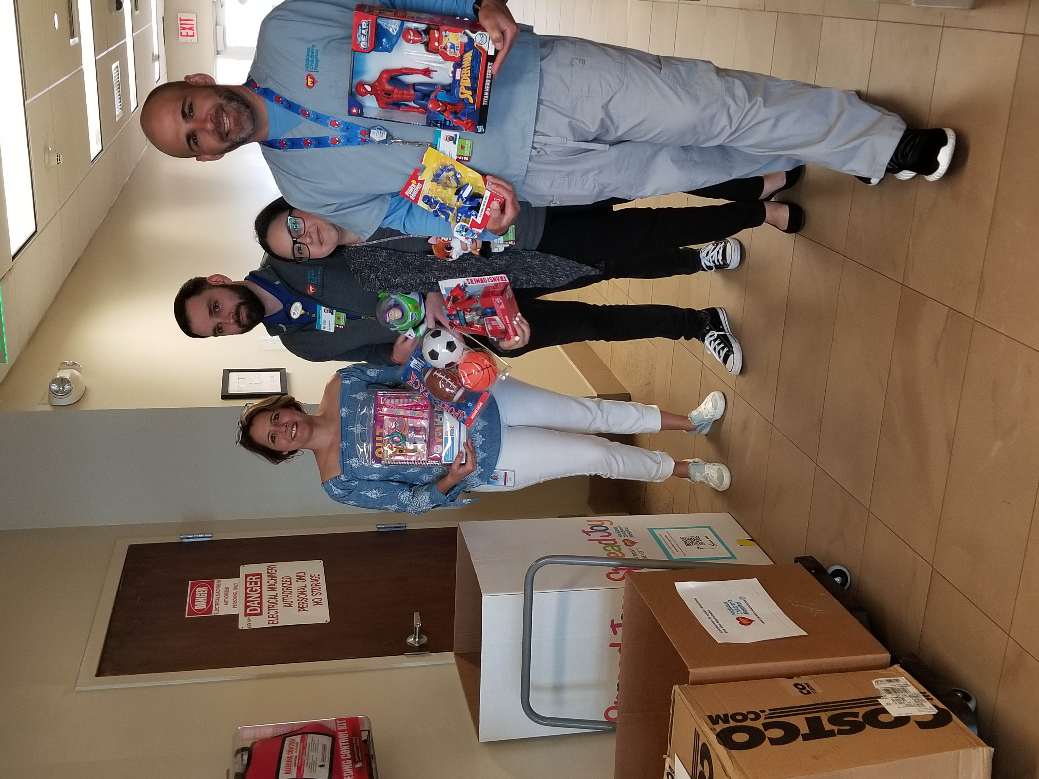 Special Delivery! Hospital employees pose with Xenia Vazquez with the toy donations