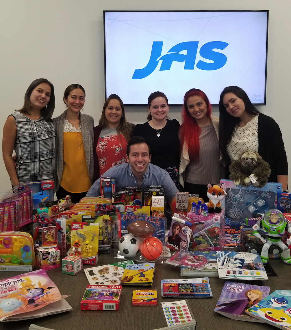 Amazing team with lots of toys! Pictured left to right: Diana Gonzalez - Export Air Specialist, Leonor Palacios – Export Ocean Specialist, Yulien Rodriguez – Export Ocean Specialist, Liliana Moreno – Export Ocean Specialist, Susan Rivas – Export Air Specialist, Itzel Rey – Data Entry, Bruno Souza – Export Air Specialist