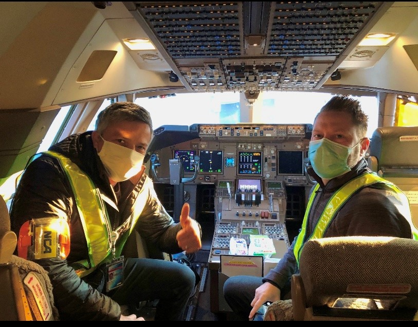 Masked Pilot and Co-pilot in a cockpit
