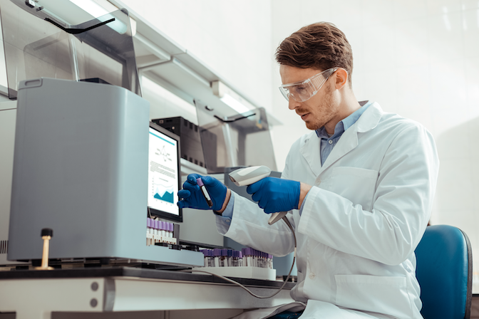 Lab technician scanning a sample.