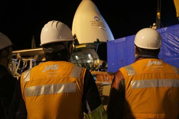 Men observing cargo loading