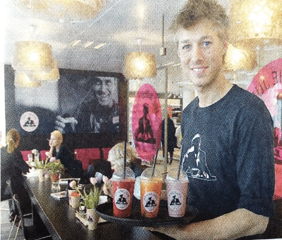"Philip ""Pippo"" Finsteen holding three different juices on plate in a JOE & THE JUICE store."