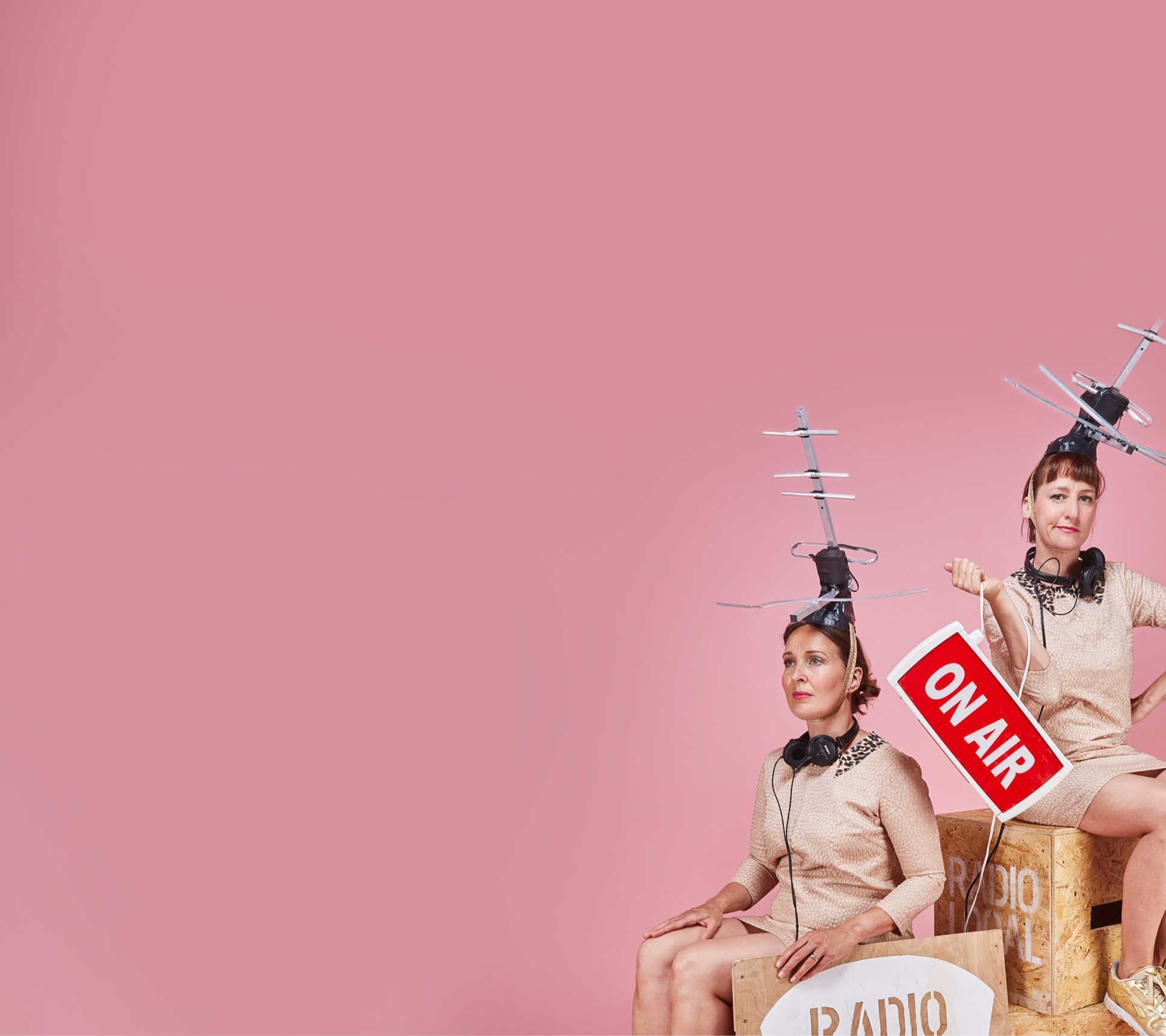 Hunt & Darton presenters on pink background with aerial hats