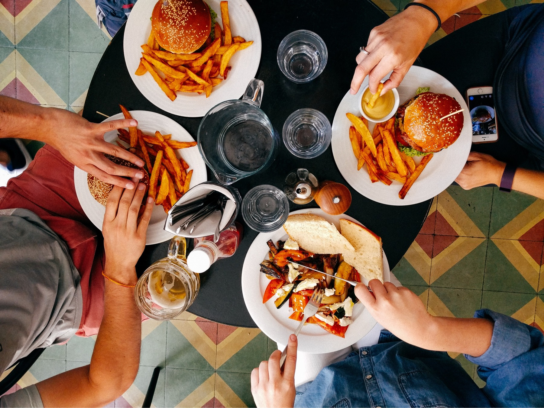 Overhead view of people eating and drinking at a restaurant