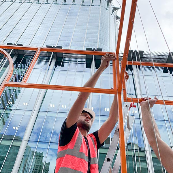 Worker installing framework at garden