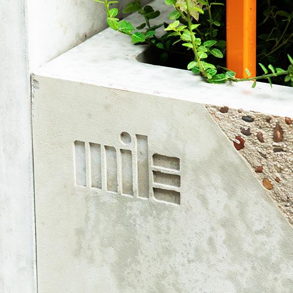Culture MILE logo marking in the concrete planters