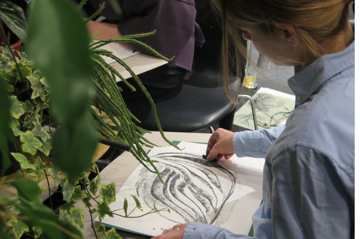 Person sketching plants