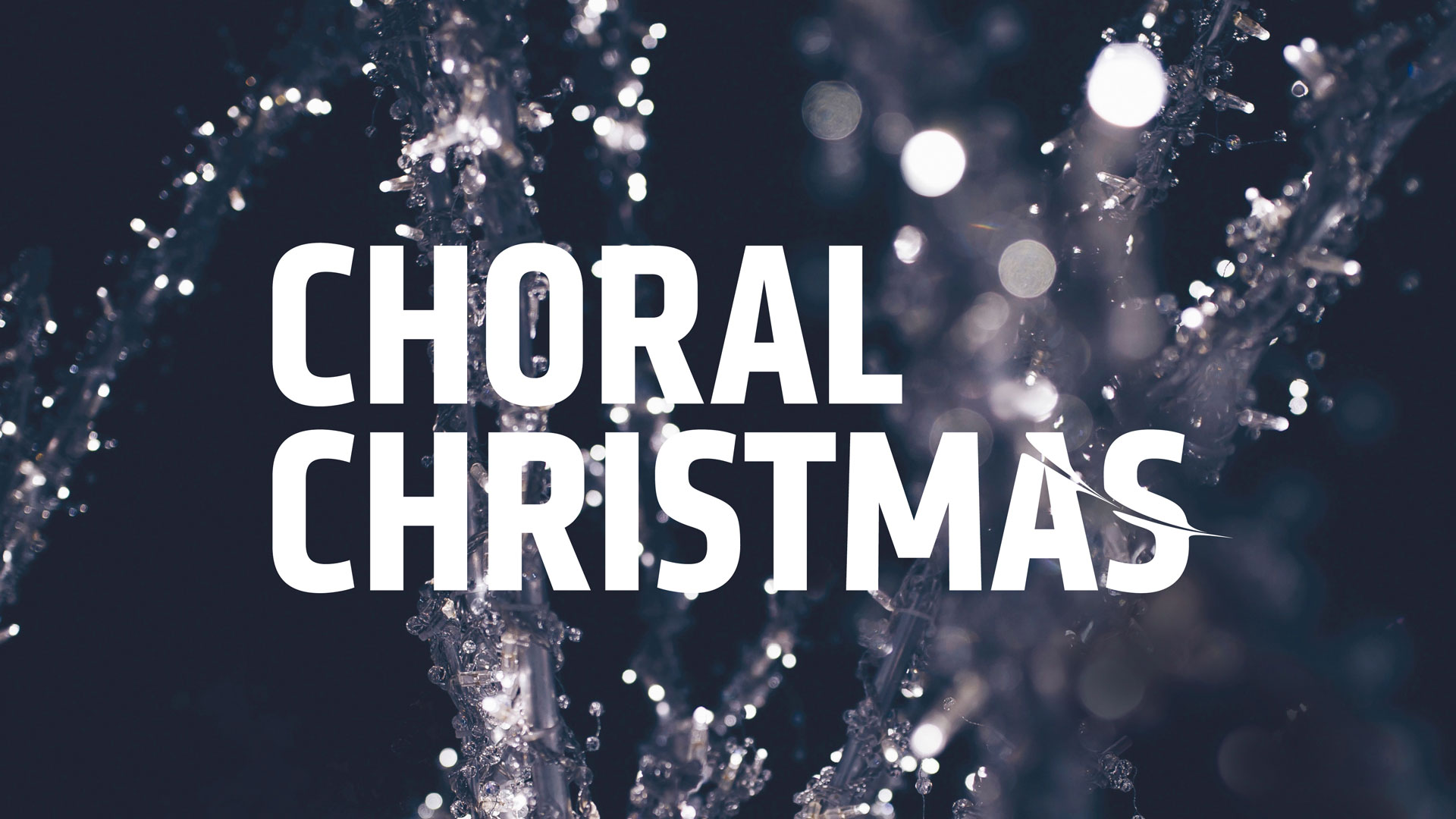 Text that reads CHORAL CHRISTMAS on a background of fairy lights