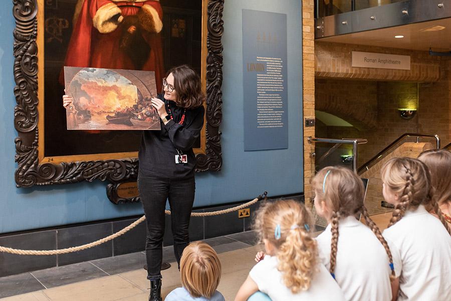 Woman showing children artwork
