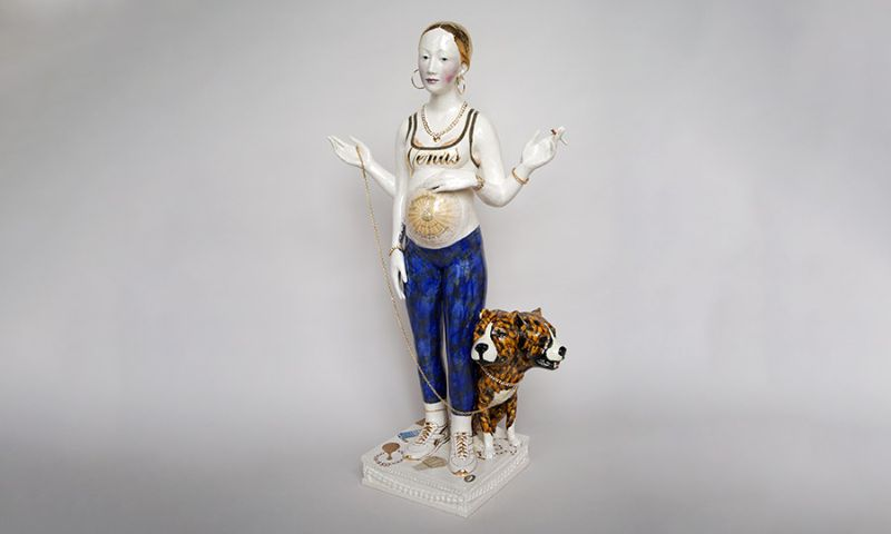Standing figure of a woman with a dog