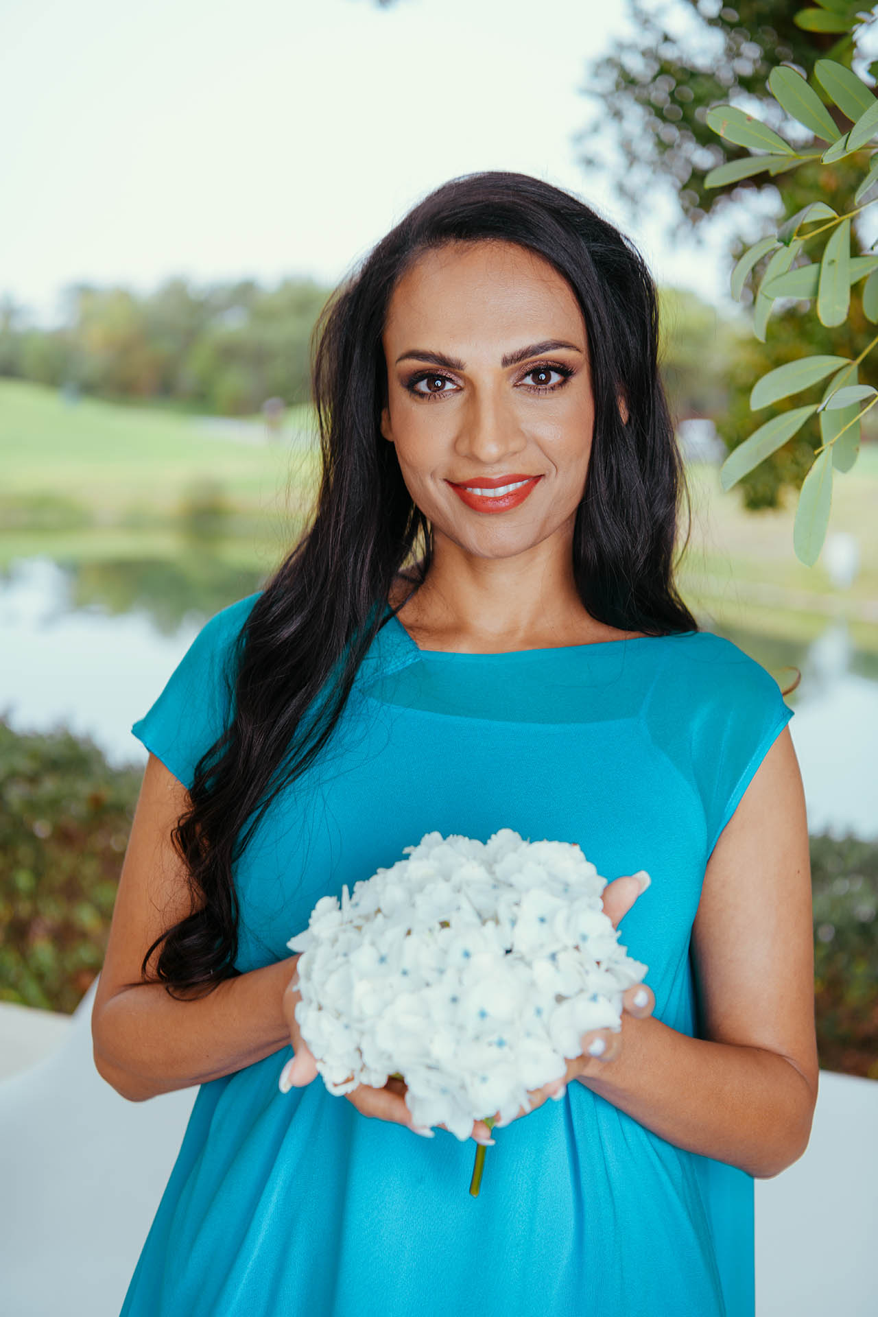 Natasha Rockstrom picture, holding flowers in a blue dress