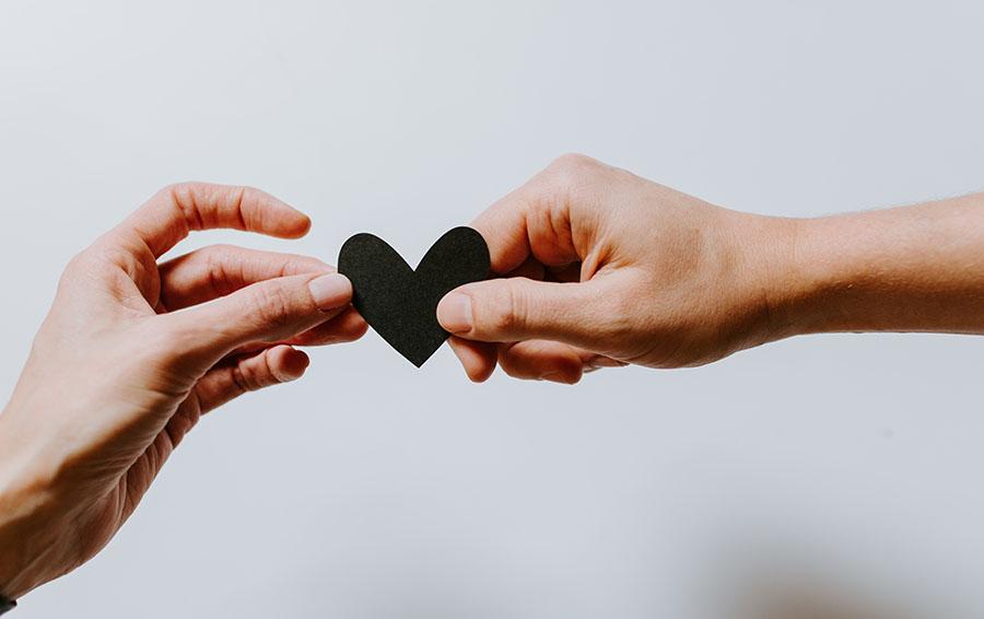 Hands sharing heart