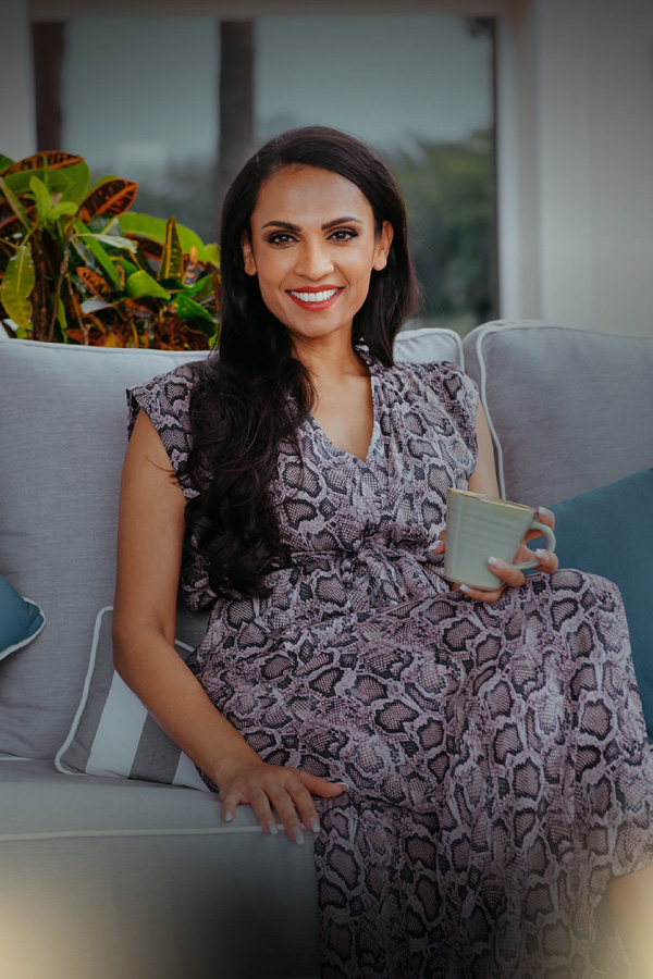 Natasha Rockstrom coaching; sitting in a sofa drinking tea