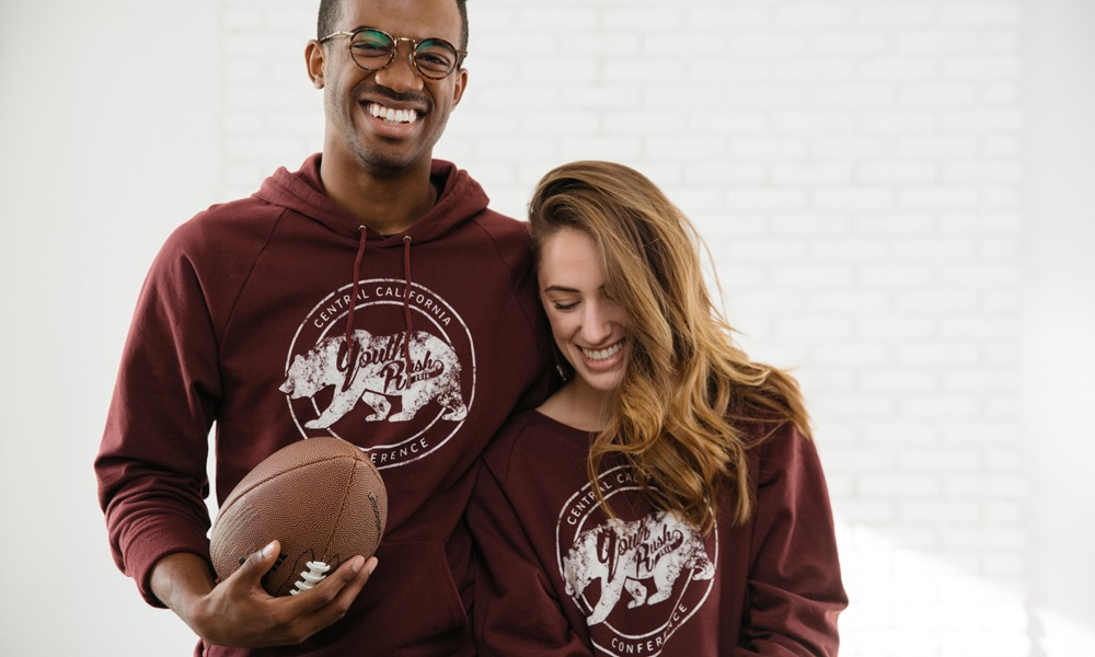 A couple celebrates their team by wearing matching shirts.
