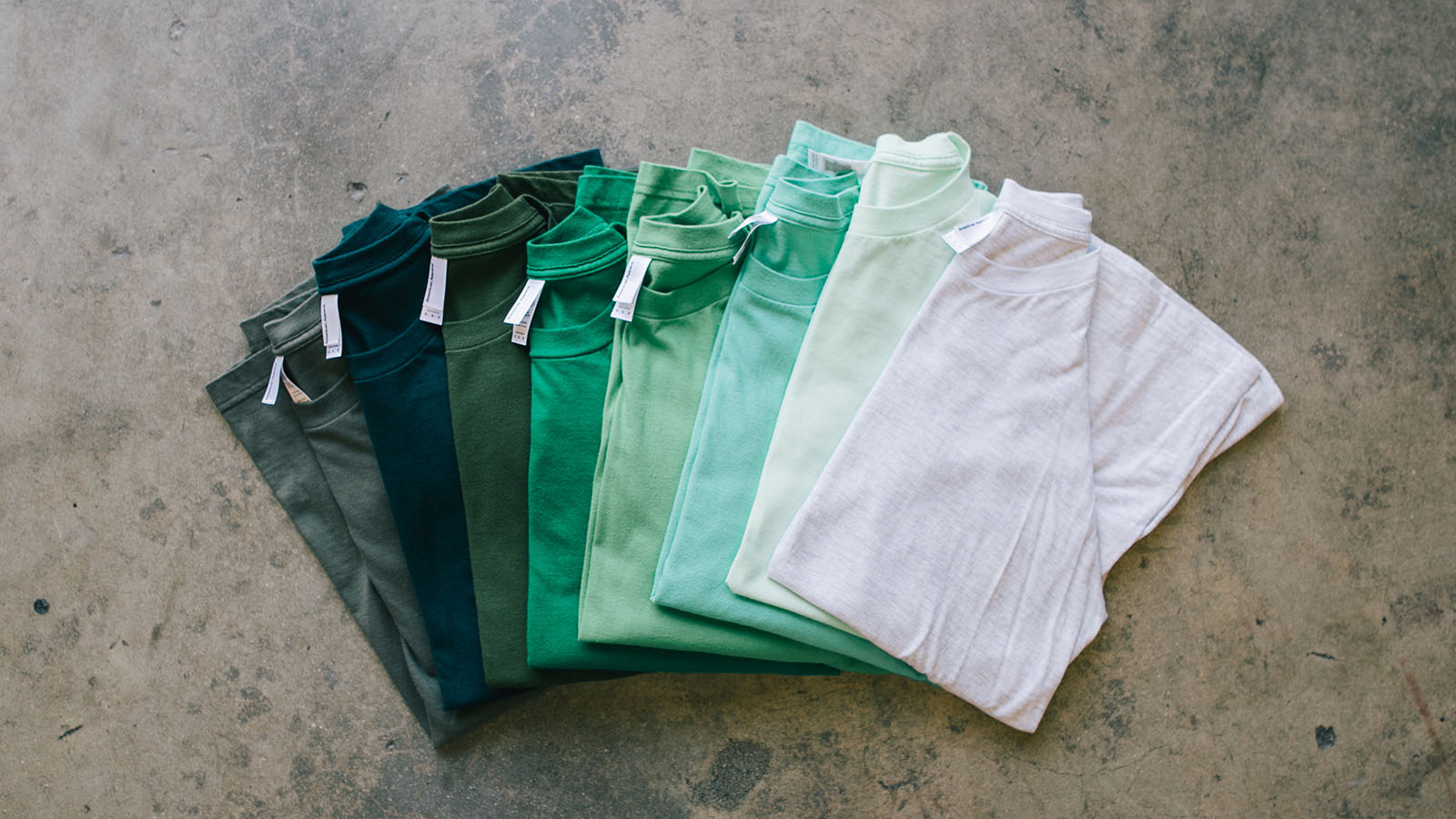 A palette of green blank t-shirts