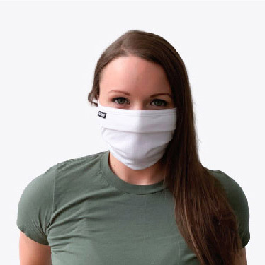 Woman wearing white face mask
