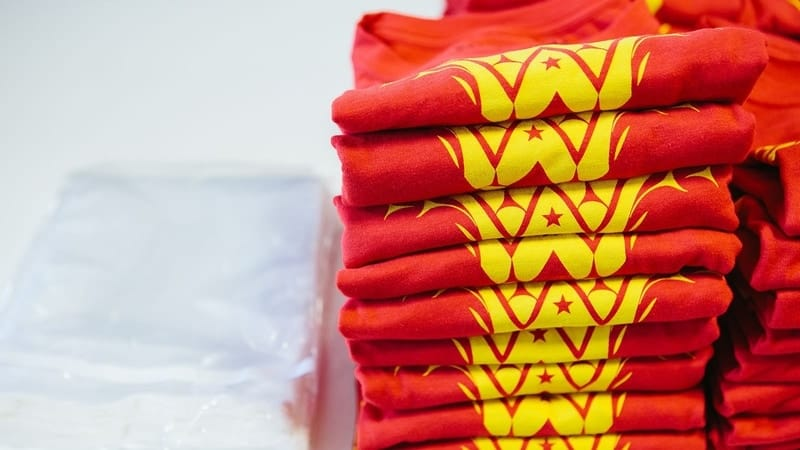 A stack of t-shirts all ready to be shipped directly to the purchaser!