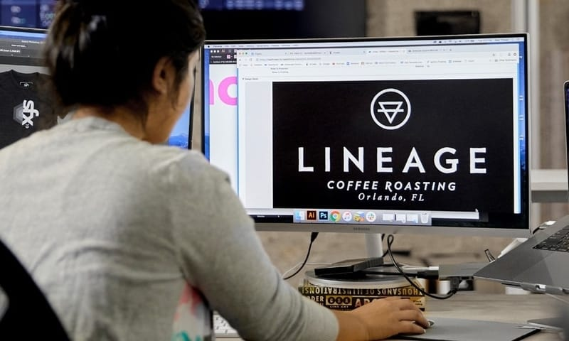 An artist works on creating a high-res mockup of a customer's custom design.