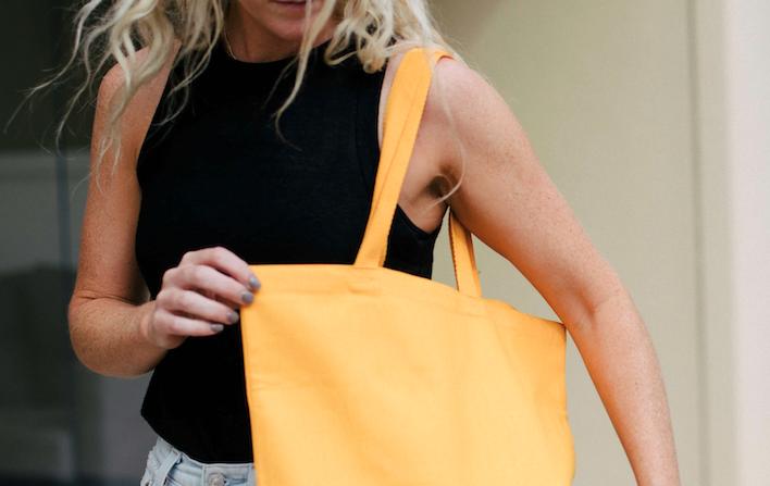 Woman with yellow custom tote bag