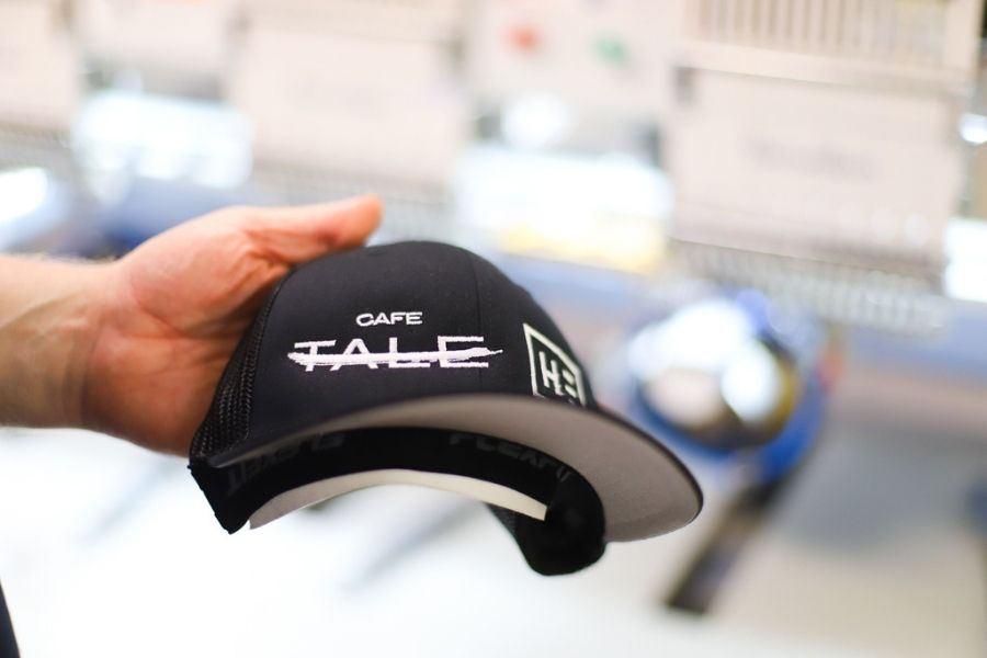 A finished hat with custom embroidered logo