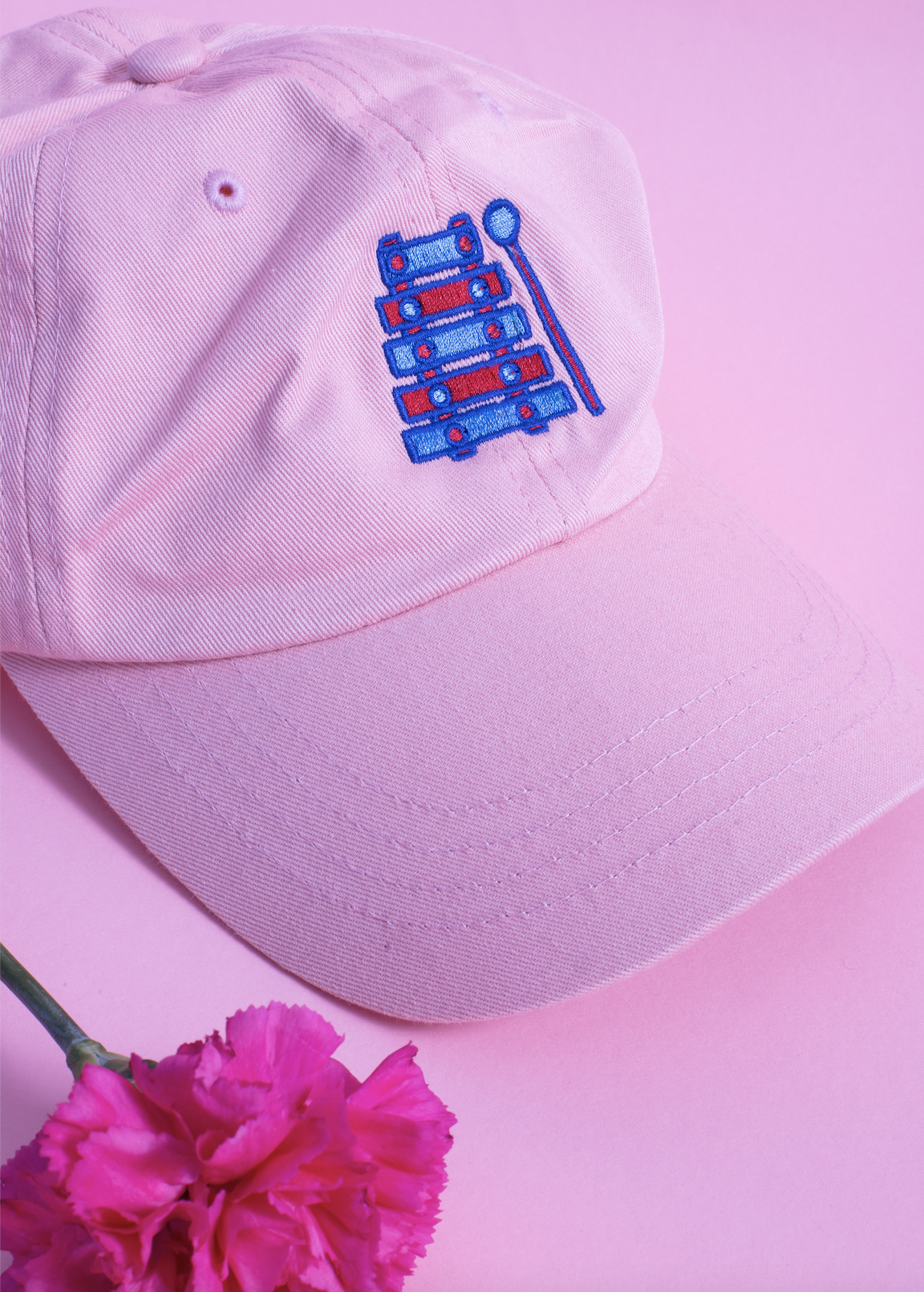 Light pink embroidered hat with a hot pink flower