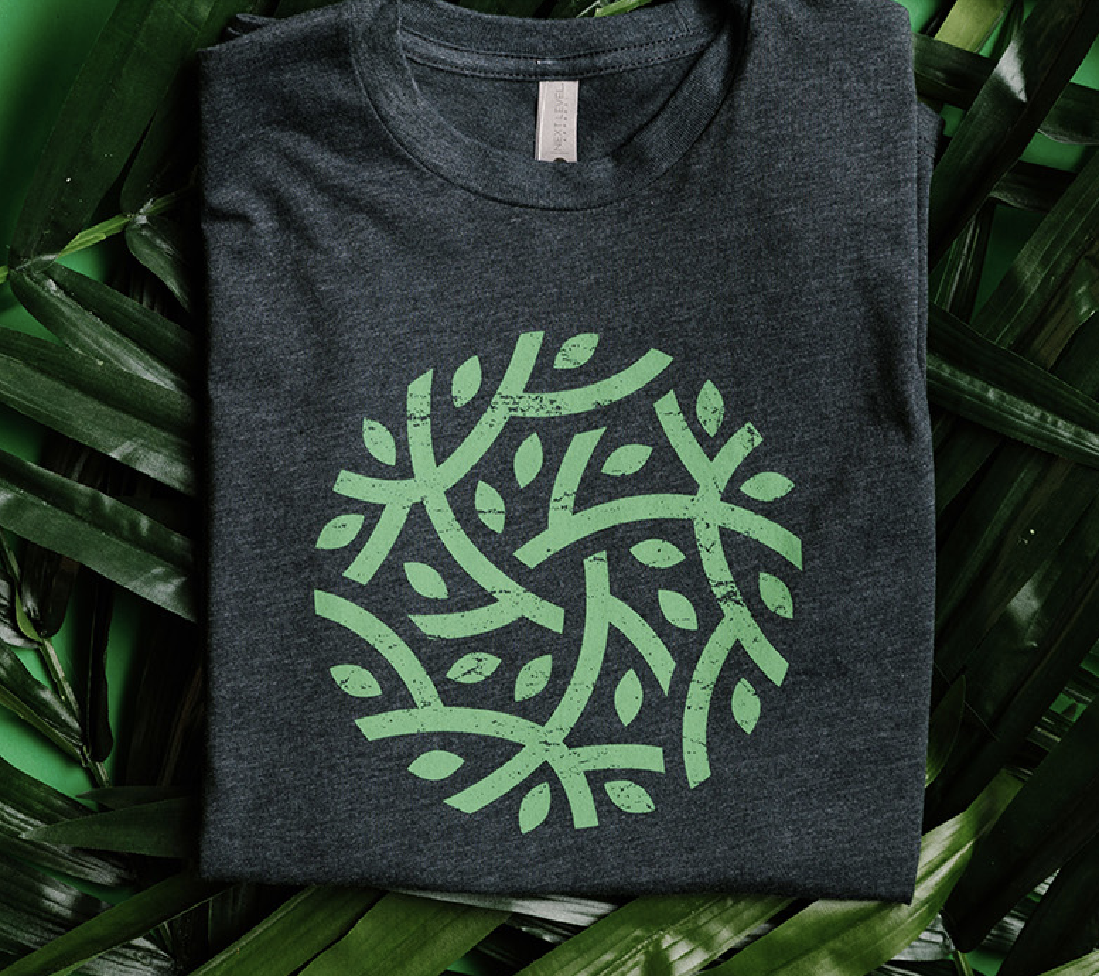 A shirt with a green plant design on the front.