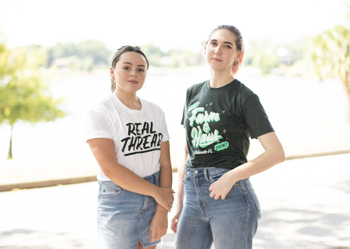Two girls wearing shirts printed with water based inks.