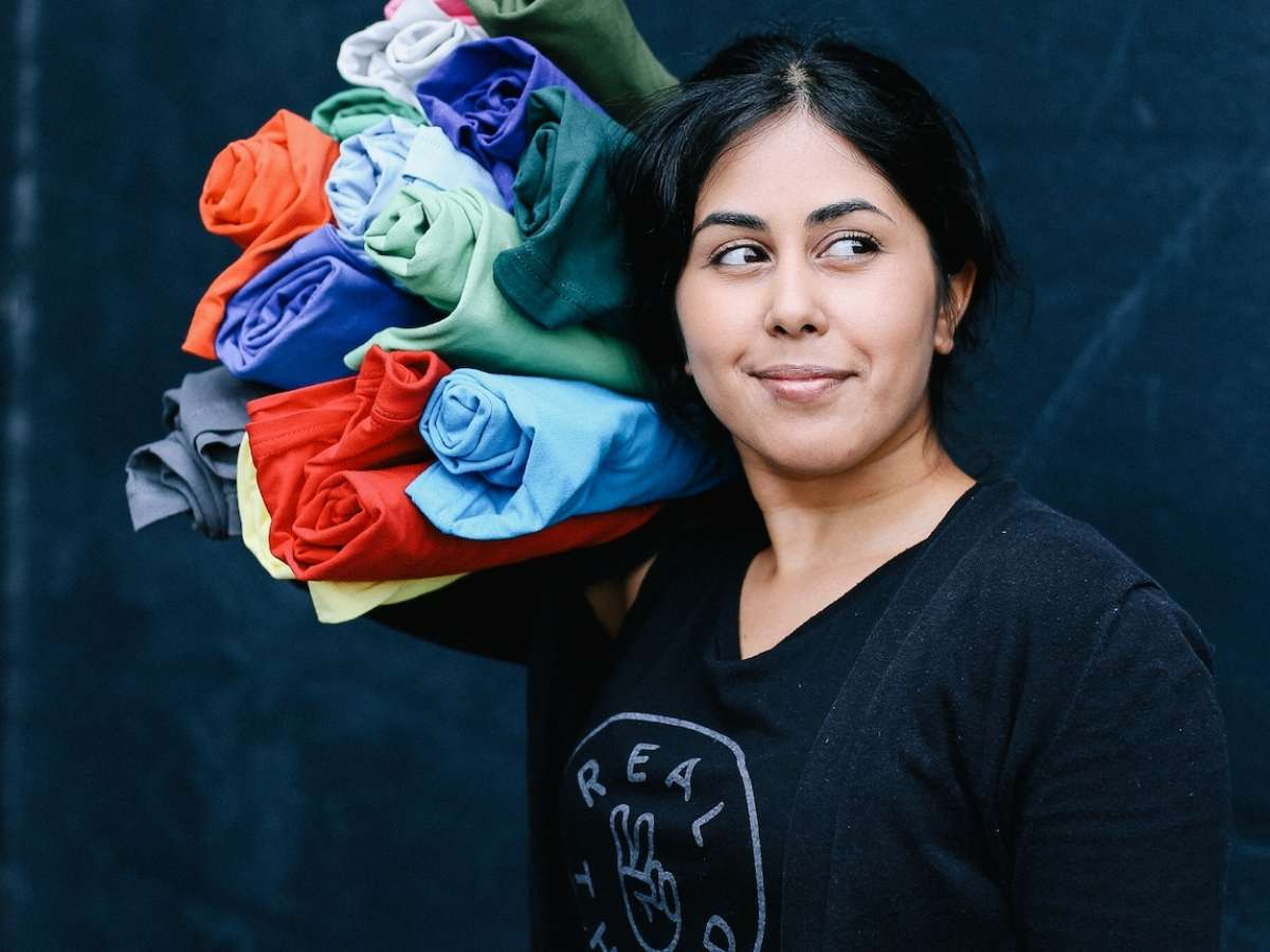 A t-shirt pro holds tons of super soft shirts to customize.