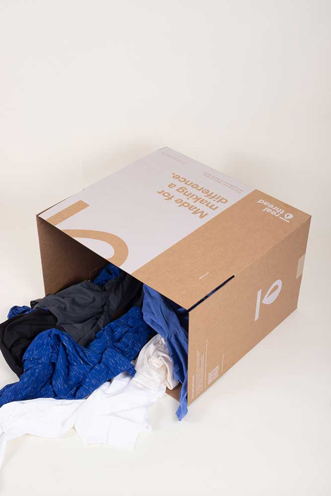"""A box that is """"made for making a difference"""" spills out some custom t-shirts."""